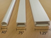 Picture of our full range of economical cable raceways, white.