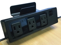 Edge mount power outlet on a desk