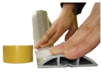 Kable Kontrol PVC floor cord cover being fastened with double sided tape