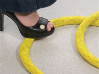 Yellow Non-skid braided sleeving covering wires on floor