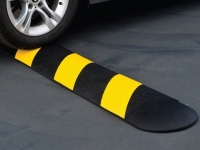 Rubber speed bump, yellow/black in use